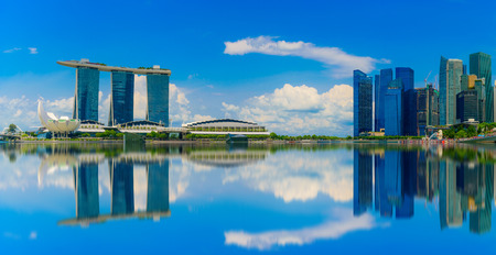 reflective: Singapore Skyline and view of skyscrapers on Marina Bay at daytime.