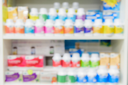 over the counter: Pharmacy interior with blurred background