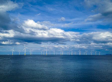 water turbine: Offshore Wind Turbine in a Wind farm under construction off coast of England, UK