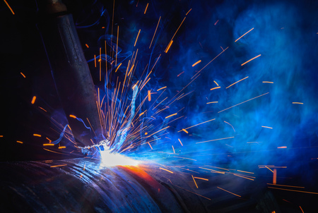 Welding steel structures and bright sparks in steel construction industry.