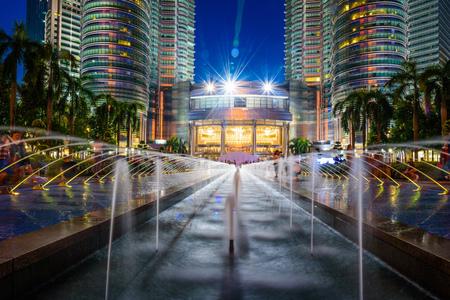 KUALA LUMPUR, MALAYSIA - JULY 29, 2017. Petronas Twin Towers at night on July 29, 2017. The tallest buildings in the world from 1998 to 2004 and remain the tallest twin towers in the world. The buildings are a landmark of Kuala Lumpur
