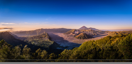 Mount Bromo volcano (Gunung Bromo) on blue sky background in Bromo Tengger Semeru National Park, East Java, Indonesia.