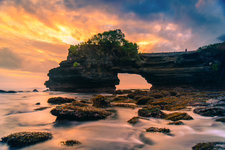 Tanah Lot Temple on sea at sunset in Bali Island, Indonesia. Stock Photo
