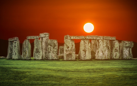 Stonehenge an ancient prehistoric stone monument at sunset in Wiltshire, UK. Editorial