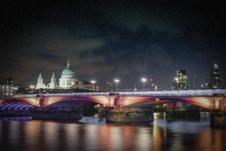 Blackfriars bridge at night with falling snow in London, UK. Stock Photo
