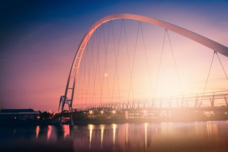 Infinity Bridge on dramatic sky at sunset in Stockton-on-Tees, UK. Stock Photo
