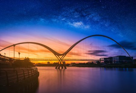 Landscape with Milky way galaxy over Infinity Bridge at sunset In Stockton-on-Tees, UK