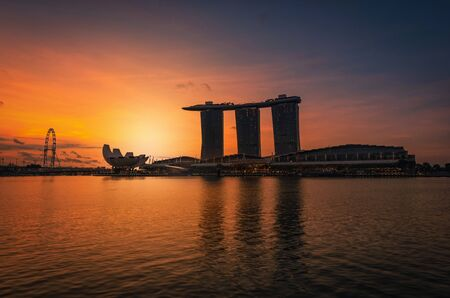 SINGAPORE - Apr 30, 2018: Panorama Singapore Skyline and view of skyscrapers on Marina Bay at sunrise.