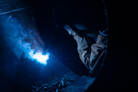 Welding steel structures and bright sparks with len flare in steel industry.