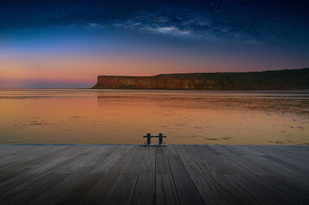 Landscape with Milky way galaxy over Cliff at Saltburn by the sea, North Yorkshire, UK Stock Photo