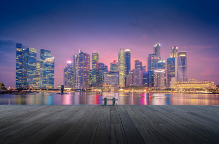 Singapore Skyline and view of skyscrapers on Marina Bay at twilight time. Stock Photo