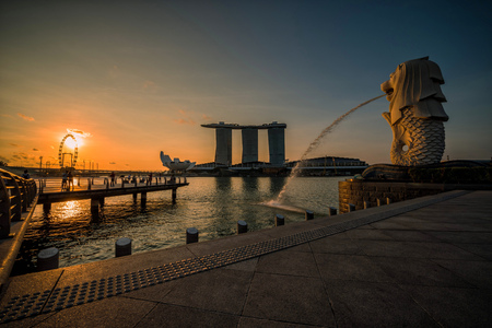 SINGAPORE-APRIL 30, 2018: Merlion statue fountain in Merlion Park and Singapore city skyline at sunrise on April 30, 2018. Merlion fountain is one of the most famous tourist attraction in Singapore. Editorial