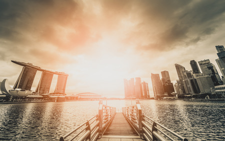Black and white image of Singapore Skyline and view of skyscrapers on Marina Bay at sunset.