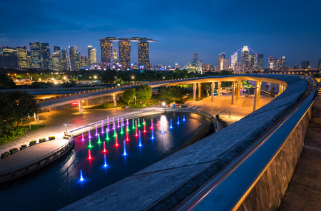 Singapore city Skyline and view of skyscrapers on Marina Barrage at twilight time. Editorial