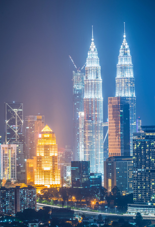 Cityscape of Kuala lumpur city skyline at night in Malaysia.