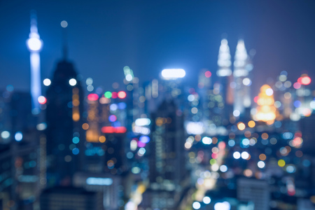 Blurred abstract background lights, beautiful cityscape view of Kuala lumpur city skyline at night in Malaysia.