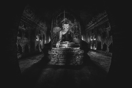 Buddha statue inside old pagoda at Bagan, Myanmar. Editorial