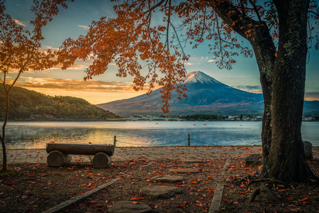 Mt. Fuji over Lake Kawaguchiko with autumn foliage at sunrise in Fujikawaguchiko, Japan. Stock Photo