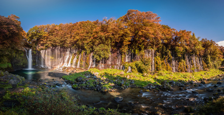 Shiraito Falls with Colorful autumn leaf in Fujinomiya, Shizuoka, Japan.