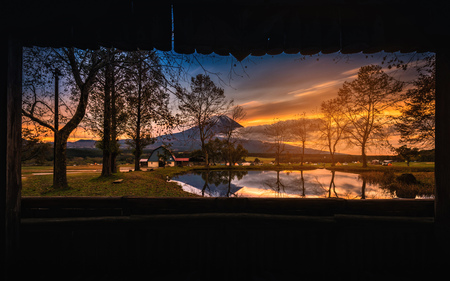 Mt. Fuji with big trees and lake at sunrise in Fujinomiya, Japan Stock Photo