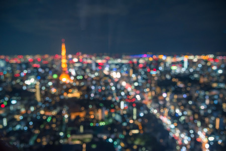 Blurred abstract background lights, beautiful cityscape view of Tokyo city skyline at night in Japan.