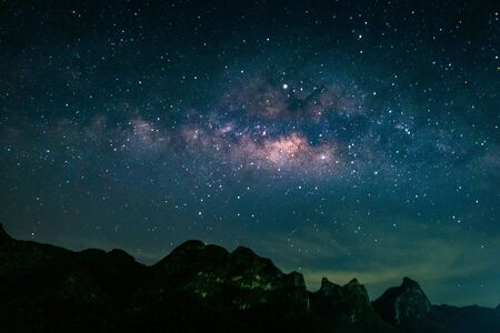 Landscape with Milky way galaxy. Night sky with stars over mountain. Long exposure photograph.