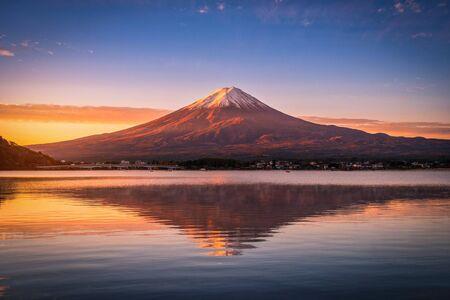 Landscape image of Mt. Fuji over Lake Kawaguchiko at sunrise in Fujikawaguchiko, Japan.