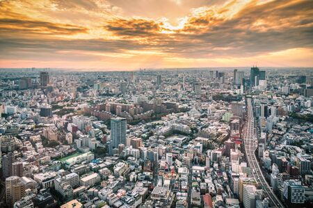 Tokyo Skyline and view of skyscrapers on the observation deck at sunset in Japan.