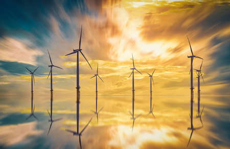 Offshore Wind Turbine in a Wind farm at sunset in Redcar, Yorkshire, UK