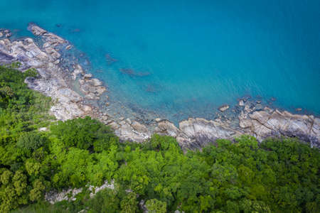 Aerial view image of sea, beach and jungle with blue  sky in Nakhon Si Thammarat, Thailand