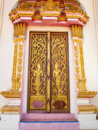 popular Buddhist deities carved on the doors and windows of the church  photo