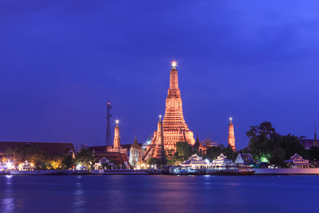 The famous Wat Arun , perhaps better known as the Temple of\ the Dawn, is one of the best known landmarks and one of the most\ published images of Bangkok. It consists of a massive elongated\ prang (Khmer-style tower), and is surrounded by four smaller\ prang