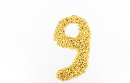 nines: Jasmine rice arranged a number nines on white background.
