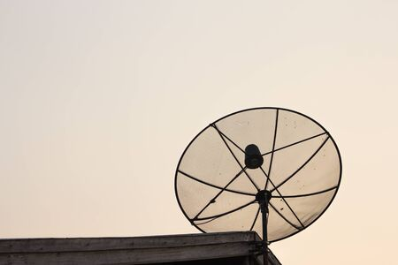 With satellite receiver mounted on the roof of a house in rural Thailand.