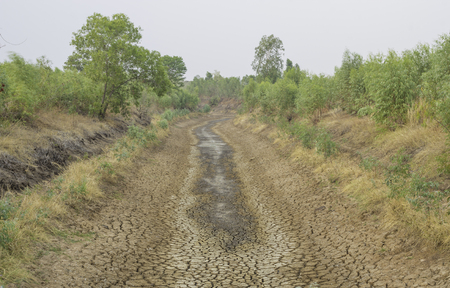 The water in the canal is dry due to the drought.