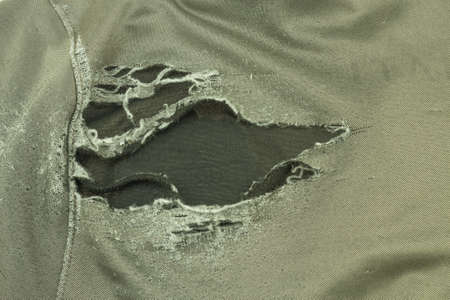 Clothes torn due to decay of the fabric