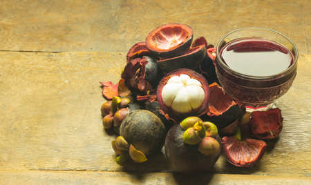 Mangosteen peel juice that is placed on the plank floor.