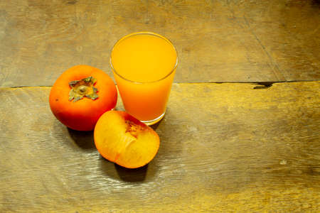 Persimmon juice placed on the wooden floor