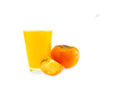 Persimmon juice isolated on white background 免版税图像