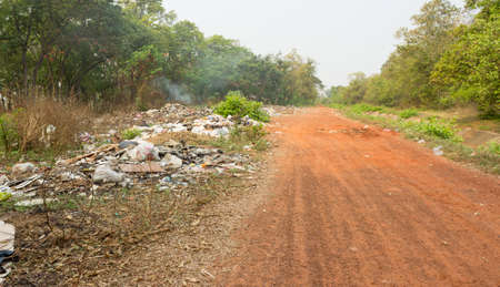 THAILAND,BURIRAM - MARCH 18,2021:Rural wastes that lack good management and cause environmental pollution. 新闻类图片