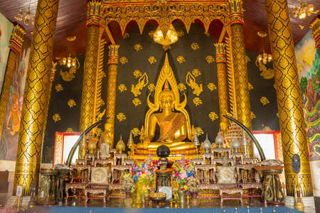 Phra Buddha Chinnarat in a chapel at Wat Sri Bueng Bun of Sisaket Province, Thailand.