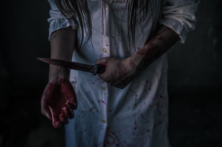 Ghost woman holding knife for kill a man with in house. Horror. Halloween. Stock Photo
