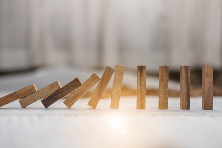 domino effect made up from wooden blocks shape toy.domino effect in business concept.the domino wooden effect concept for business.