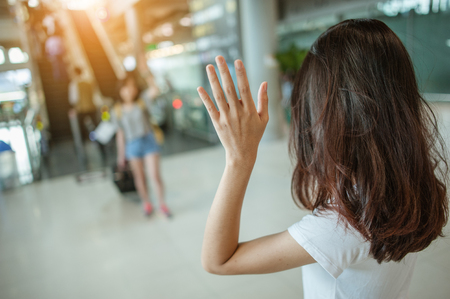 Asian girl Will be embracing friends from abroad.airports concept.airports hug. Stock fotó