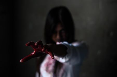 Horror Scene of a Woman with Bloody Hands . Stock Photo