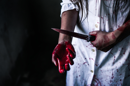 Ghost woman holding knife for kill a herself with in house. Horror. Halloween.horror of scary fear on hell is monster devil girl in halloween festival concept