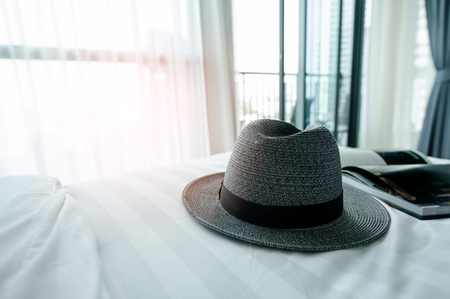 Straw hat on bed. vacation concept