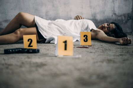 Woman was killed after raped by thief.Crime Concept.Criminality Concept.Investigations found evidence of blood and condom use.