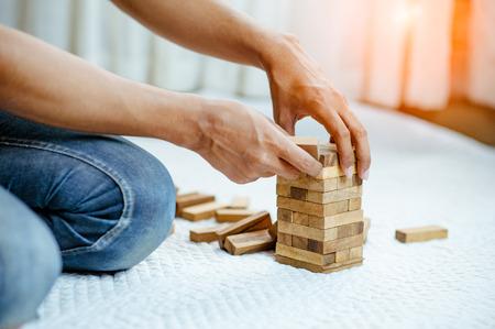 restart wood block tower.Failure and then restart. Banque d'images