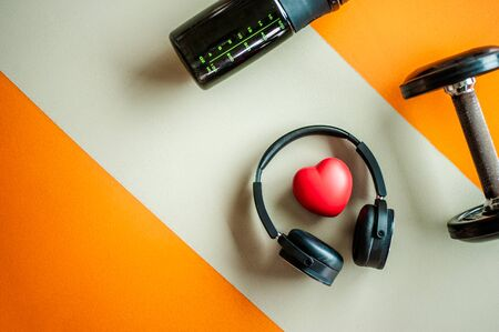 bottle of waters,dumbbell,headphone,background. copy space Fitness, healthy and active lifestyles Concept 스톡 콘텐츠 - 145872596